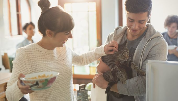 couple at party with cat
