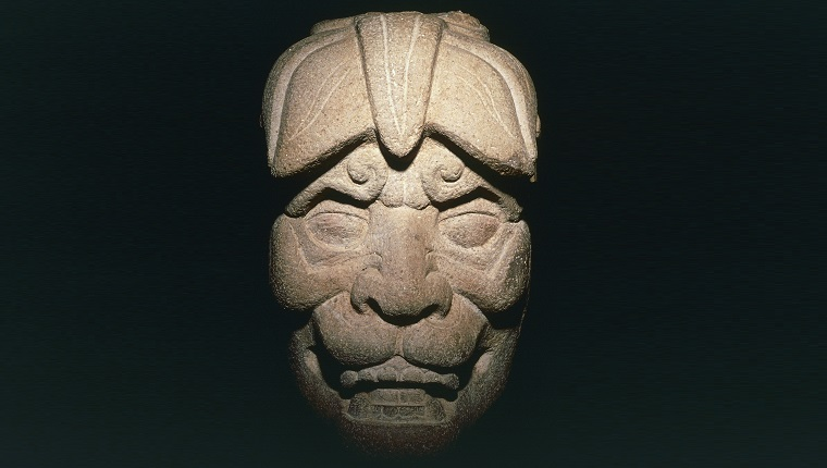 GUATEMALA - CIRCA 2003: Mask of the Jaguar god, stone, found during excavations in Kaminaljuyu, Guatemala. Mayan civilisation, Middle Preclassic Period.